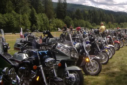 Long lines of motorcycles stretch into the distance.