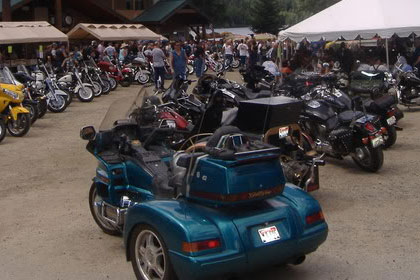 Motorcycles line the parking lot outside of event.