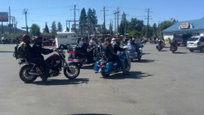 Lots of riders on their motorcycles.