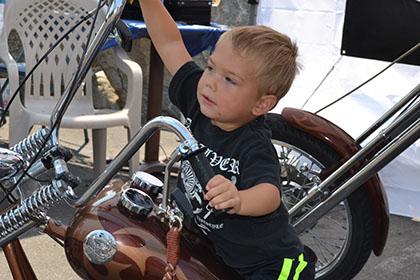 Young child on a motorcycle.