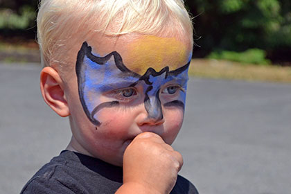 Child with a painted face.