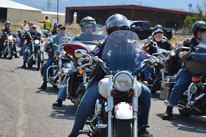 A line of riders on their motorcycles.
