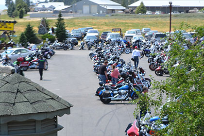 Motorcycles fill the parking lot at the event.