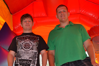 Posing for their photo in the bouncy castle.