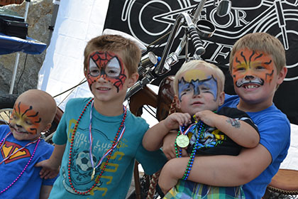 Children with their face painted.