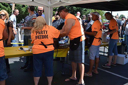 Ride for Life volunteers serving barbecue food at the event.