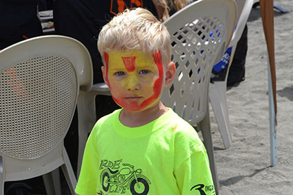 Child with his face painted.