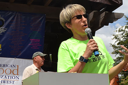 Ride for Life committee member speaking on a microphone.