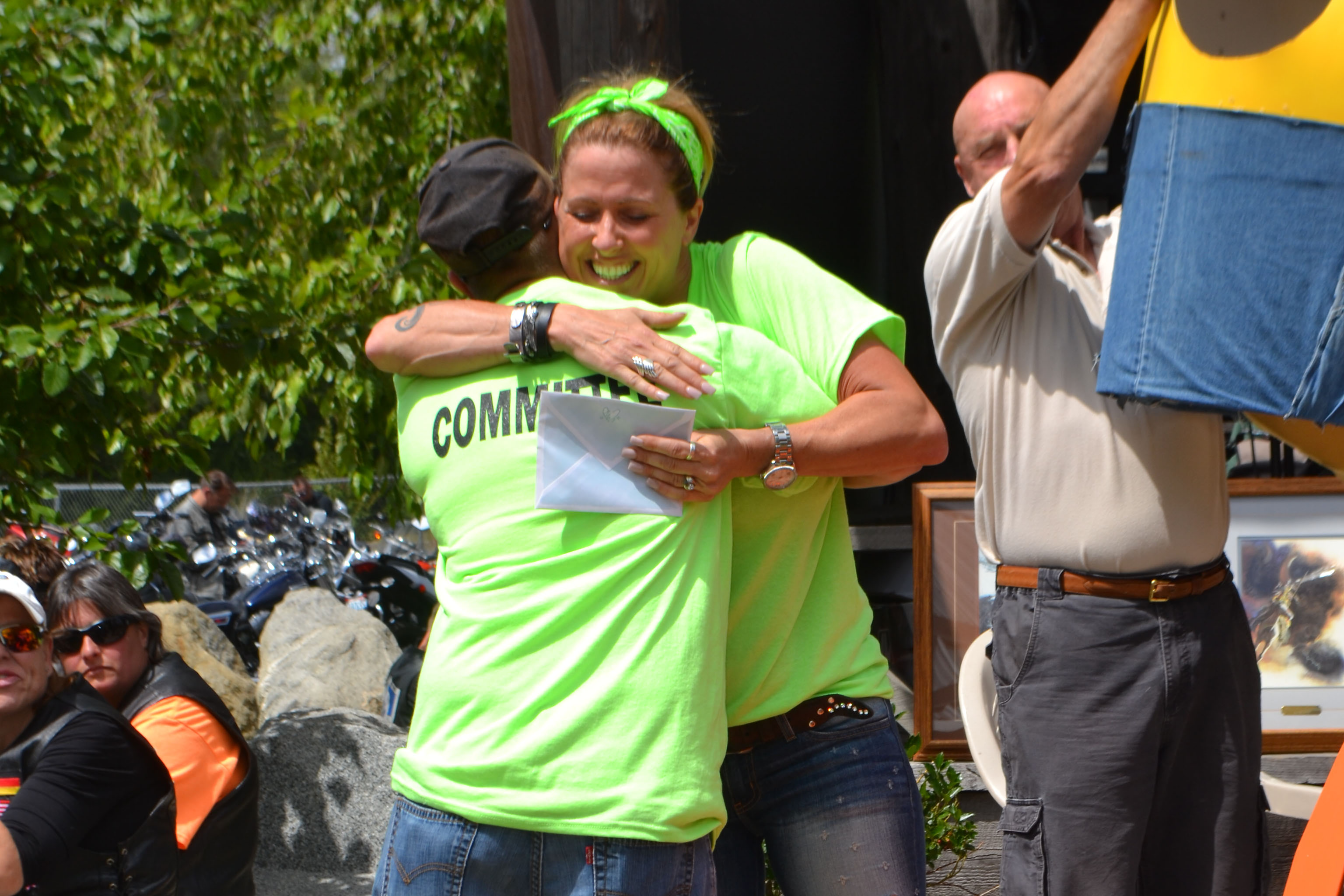 Two Ride for Life committee members embracing each other.