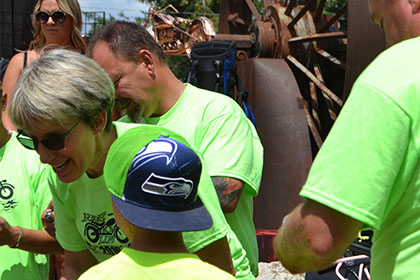 Child wearing a Seattle Seahawks hat with some Ride for Life committee members.