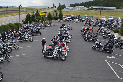 Motorcycles and vehicles in the parking lot.
