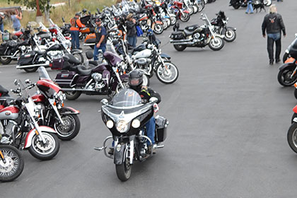 Rows of motorcycles.