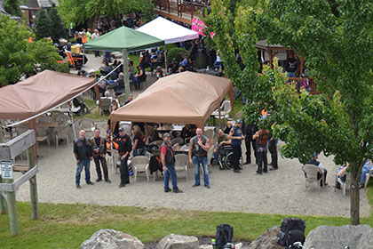 Some motorcycles, tents, and people.