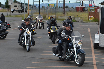 Riders gather in the parking lot.