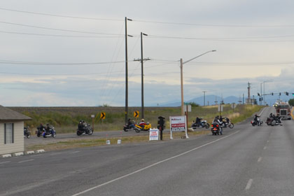 Pausing traffic while riders embark on their ride route.