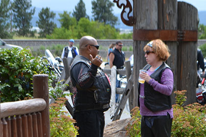 Two people talking near the event entrance.
