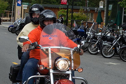 Two people on a motorcycle.