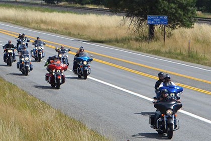 Group of motorcylces on the road.