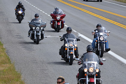 Group of seven riders on their motorcycles.
