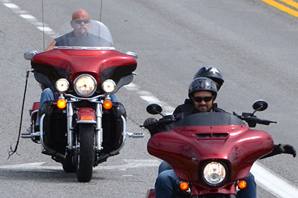 Riders on their motorcycles.