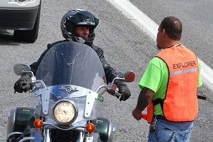 A man on his motorcycle speaks to a Ride for Life committee member.